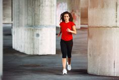 Fit woman running stock images