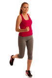 Fit woman running isolated over white background Stock Images