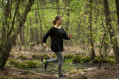 Fit woman running outdoors Royalty Free Stock Photography
