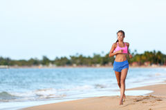Fit Woman Running On Shore Against Sky Royalty Free Stock Photography