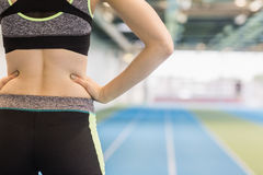 Fit woman on the running track Stock Photos
