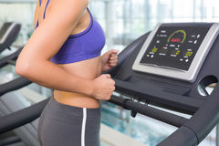 Fit woman running on the treadmill Stock Image
