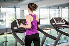 Fit woman running on treadmill Stock Photos