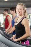 Fit woman running on treadmill Royalty Free Stock Photography