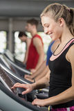 Fit woman running on treadmill Royalty Free Stock Images