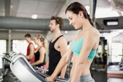 Fit woman running on treadmill Royalty Free Stock Image