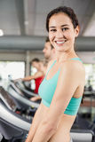 Fit woman running on treadmill Royalty Free Stock Photos