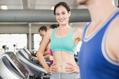 Fit woman running on treadmill Stock Image