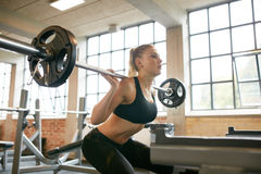 Fit woman running on treadmill in gym Stock Photography