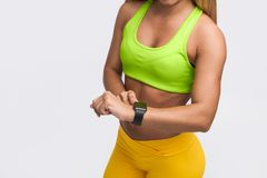 Fit woman setting time Royalty Free Stock Photos