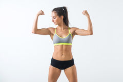 Fit woman showing biceps warming up exercising doing sports, fitness workout royalty free stock photo