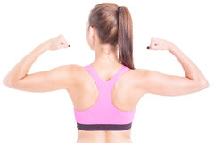 Fit woman showing her back and biceps muscles Royalty Free Stock Photography
