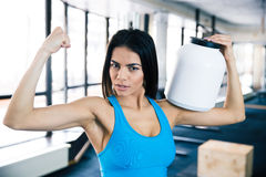 Fit woman showing her muscles Royalty Free Stock Photo