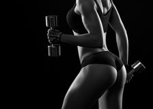 Fit woman showing off her perfect figure at the studio monochrom Stock Photo
