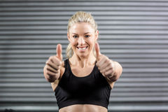 Fit woman showing thumbs up Royalty Free Stock Photography