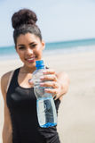Fit woman showing water bottle Stock Photo