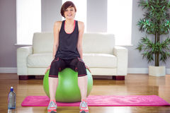 Fit woman sitting on exercise ball Stock Photography