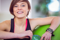 Fit woman sitting next to exercise ball Royalty Free Stock Photo