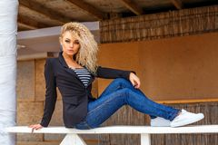 Fitness woman in jeans and blazer stock image