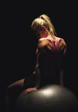 Fit Woman Sitting on a Yoga Ball Royalty Free Stock Image