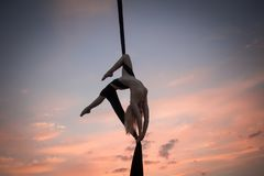 Young woman practicing aerial sylks royalty free stock photo