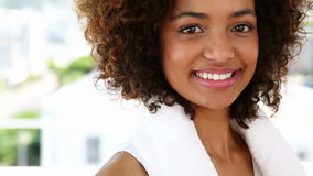 Fit woman smiling at camera. At the gym stock footage