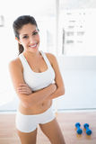 Fit woman smiling at camera Royalty Free Stock Images