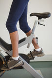 Fit woman on the spin bike. At the gym Royalty Free Stock Photo