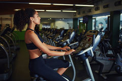 Fit woman in a spin class at gym Stock Photography