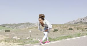 Fit woman in sportive clothing stretching body stock video footage