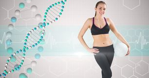 Fit woman in sportswear by DNA structures Royalty Free Stock Image