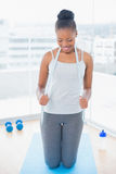 Fit woman in sportswear holding measuring tape around her neck Royalty Free Stock Images