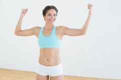 Fit woman in sportswear standing with clenched fists Stock Images