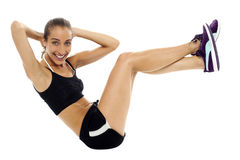 Fit woman in sporty attire doing crunches Royalty Free Stock Photo