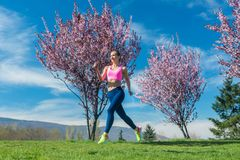 Woman in spring running or jogging as sport stock images