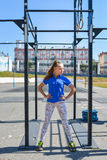 Fit woman standing in confidence pose preparing to do pull ups on horizontal bar Stock Photography