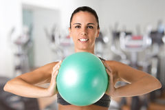 Fit Woman Standing Holding a Pilates Ball Royalty Free Stock Photo