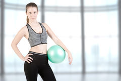 Fit Woman Standing Holding a Pilates Ball Royalty Free Stock Image