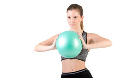 Fit Woman Standing Holding a Pilates Ball Royalty Free Stock Photos