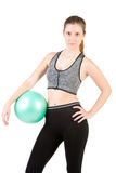 Fit Woman Standing Holding a Pilates Ball Stock Photo