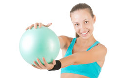 Fit Woman Standing Holding a Pilates Ball Stock Image