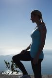Fit woman standing looking out to sea Royalty Free Stock Images