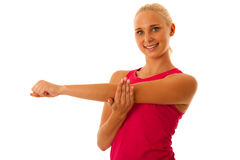Fit woman stretch arm  isolated over white Royalty Free Stock Image