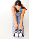 Fit woman stretching Stock Images