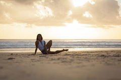 Fit woman stretching on beach Stock Photo