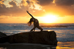 Fit woman stretching on beach Royalty Free Stock Photography