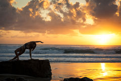 Fit woman stretching on beach Royalty Free Stock Photo