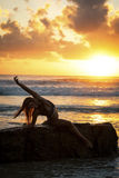 Fit woman stretching on beach Royalty Free Stock Images