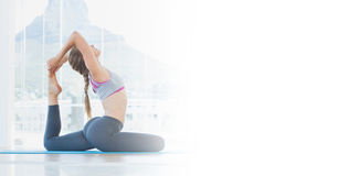Fit woman stretching body in exercise room Royalty Free Stock Image