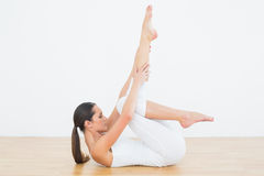 Fit woman stretching body in fitness studio Stock Image